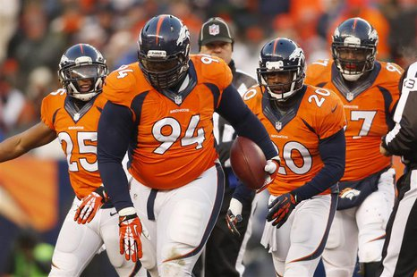 Dec 8, 2013; Denver, CO, USA; Denver Broncos defensive tackle Terrance Knighton (94) after catching an interception during the second half a