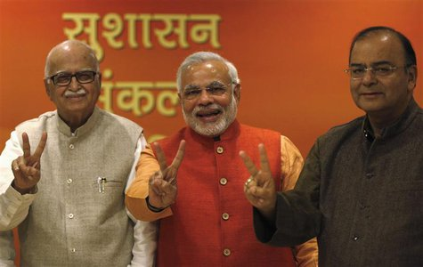 (From L - R) India's main opposition Hindu-nationalist Bharatiya Janata Party (BJP) leader Lal Krishna Advani, Gujarat's chief minister and