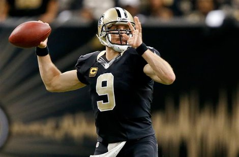 Dec 8, 2013; New Orleans, LA, USA; New Orleans Saints quarterback Drew Brees (9) throws a pass against the Carolina Panthers during the seco