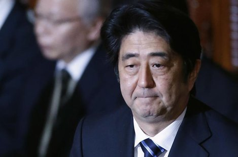 Japan's Prime Minister Shinzo Abe attends at the plenary session of the Lower House of the parliament as it rejects a no-confidence resoluti