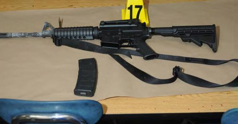 A Bushmaster rifle belonging to Sandy Hook Elementary school gunman Adam Lanza in Newtown, Connecticut is seen after its recovery at the sch