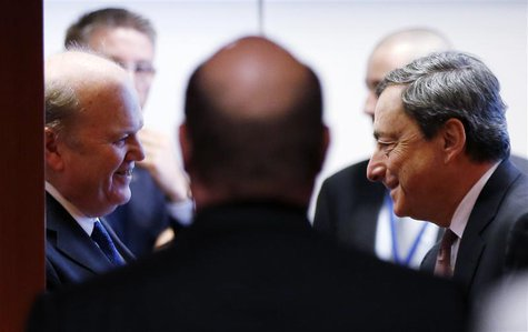 Ireland's Finance Minister Michael Noonan talks to European Central Bank (ECB) President Mario Draghi (R) during an eurozone finance ministe