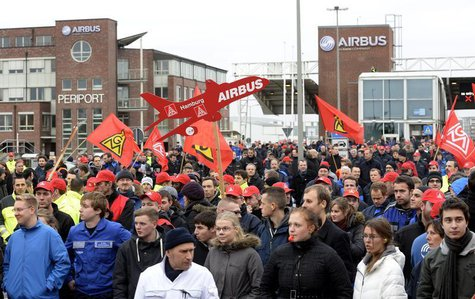 Employees of aircraft company Airbus demonstrate in front of the German headquarter Hamburg-Finkenwerder against planned restructuring measu