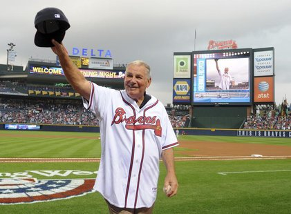 Former Atlanta Braves manager Bobby Cox waves to the crowd after throwing out the first pitch at the start of their home opening MLB Nationa