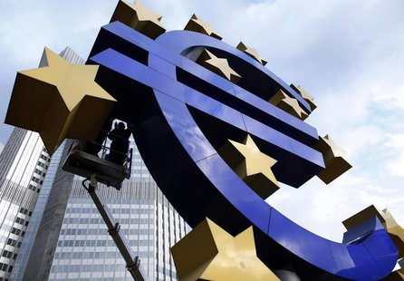 Workers maintain the huge Euro logo in front of the headquarters of the European Central Bank (ECB) in Frankfurt, December 6, 2011. REUTERS/