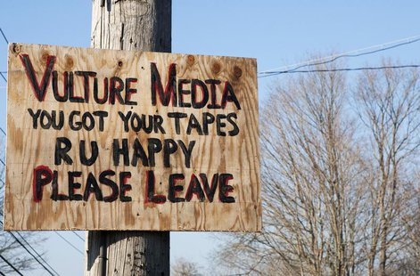 A sign expressing displeasure with the media is tacked on a pole in Newtown, Connecticut December 4, 2013. REUTERS/Michelle McLoughlin
