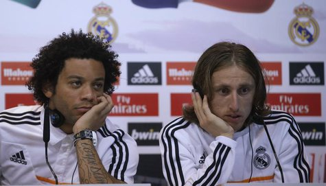 Real Madrid's Marcelo (L) and Luka Modric attend a news conference to discuss the draw for the 2014 World Cup at the Valdebebas training gro