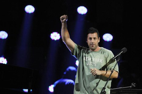 "Adam Sandler performs during the ""12-12-12"" benefit concert for victims of Superstorm Sandy at Madison Square Garden in New York December 12"