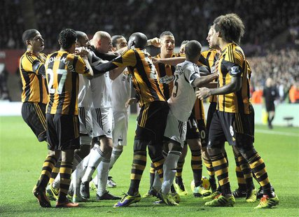 Swansea City and Hull City players scuffle during their English Premier League soccer match at the Liberty Stadium in Swansea, Wales, Decemb