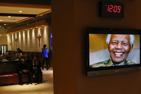 Nelson Mandela is pictured on a display screen as people attend a tribute service for him at the Christian Cultural Center in the Brooklyn a