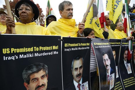 Supporters of Iranian opposition group Mujahadin-e-Khalq (MEK) rally against Iraq's Prime Minister Nuri al-Maliki hours before he is schedul