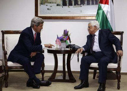 U.S. Secretary of State John Kerry (L) meets Palestinian President Mahmoud Abbas in the West Bank city of Ramallah December 5, 2013. REUTERS