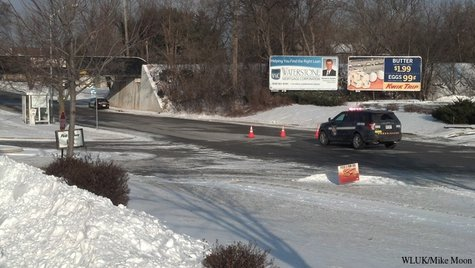 A State Patrol vehicle blocks off a road near the intersection of S. Main St. and Pioneer Rd. in Fond du Lac, Monday, Dec. 9, 2013. (Photo from FOX 11).