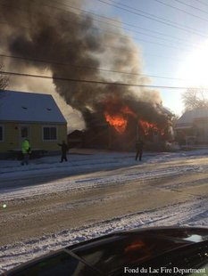 Firefighters battle a house fire at 65 N. Hickory St. on Monday, Dec. 9, 2013. (Photo from Fond du Lac Fire Department)