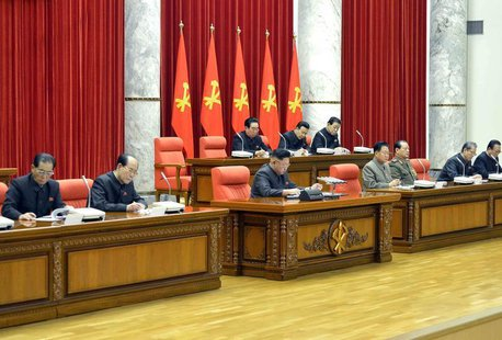 North Korean leader Kim Jong Un (front C) attends a meeting of the ruling Workers' Party politburo in Pyongyang, in this undated photo relea