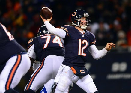 Dec 9, 2013; Chicago, IL, USA; Chicago Bears quarterback Josh McCown (12) throws a pass during the third quarter against the Dallas Cowboys