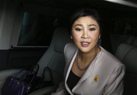 Prime Minister Yingluck Shinawatra leaves Army Club where she held a cabinet meeting in Bangkok December 10, 2013. Yingluck pleaded on Tuesd