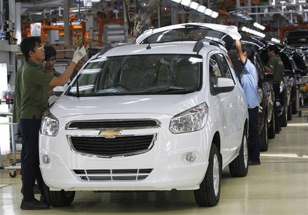 Workers make final checks on new Chevrolet Spin MPVs at a General Motors plant in Bekasi, on the outskirt of Jakarta, in this February 19, 2