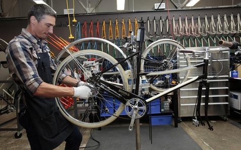 Max Stchelcine assembles a Shinola three-speed bicycle at the newly opened Shinola luxury bike and watch store in midtown Detroit, Michigan