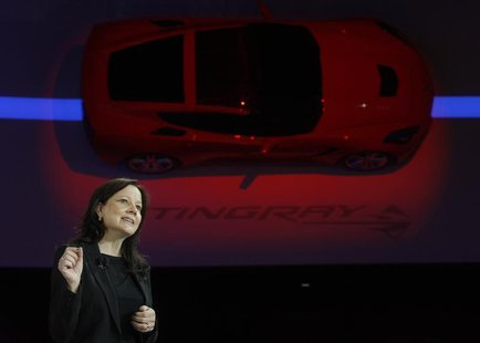 Mary Barra, Senior VP of General Motors Global Product Development, speaks near a 2014 Corvette Stingray at the North American International