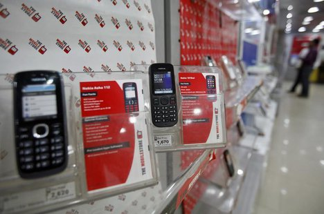 Low-cost mobile handsets from Nokia on display at a store in the western Indian city of Ahmedabad March 4, 2013. REUTERS/Amit Dave