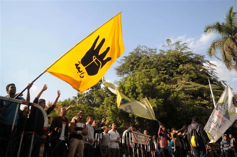 Students of Cairo University, who are supporters of the Muslim Brotherhood and ousted Egyptian President Mohamed Mursi, wave a flag bearing