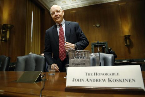 John Koskinen takes his seat to testify before a Senate Finance Committee confirmation hearing on his nomination to be commissioner of the I