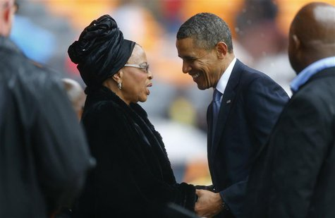 U.S. President Barack Obama (2nd R) pays his respect to former South African President Nelson Mandela's widow Graca Machel (2nd L) after his