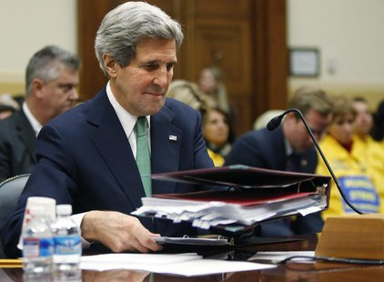 U.S. Secretary of State John Kerry places his notes on the table before testifying on agreements over Iran's nuclear programs, before the Ho