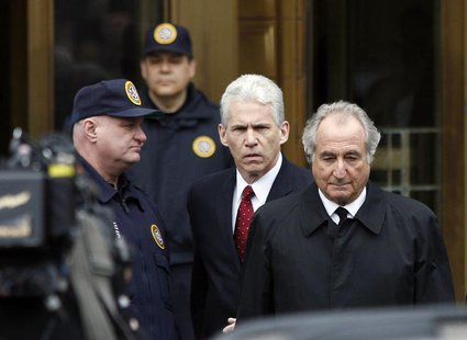 Bernard Madoff (R) exits the Manhattan federal courthouse in New York March 10, 2009. REUTERS/Shannon Stapleton