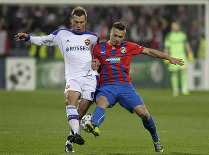 CSKA Moscow's Aleksei Berezutski (L) challenges Viktoria Plzen's Stanislav Tecl during their Champions League soccer match in Plzen December