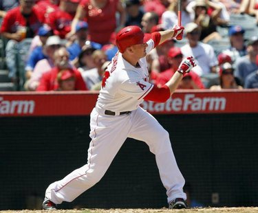 Los Angeles Angels' Mark Trumbo hits a three-run home run against the Toronto Blue Jays in the fourth inning during their MLB American Leagu