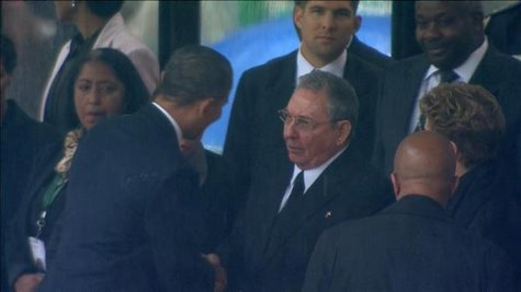 U.S. President Barack Obama (2nd L) shakes hands with Cuban President Raul Castro (C) in this still image taken from video courtesy of the South Africa Broadcasting Corporation (SABC) at the First More... CREDIT: REUTERS/SABC VIA REUTERS TV