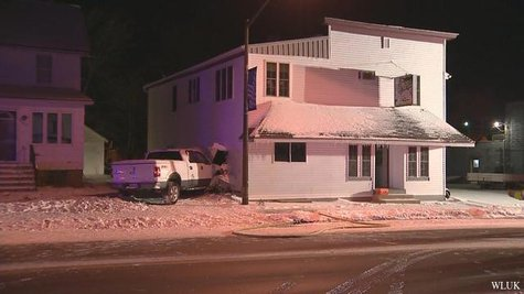 White pickup truck slams into Black Creek business on Monday Dec. 9, 2013. (Photo from FOX 11).