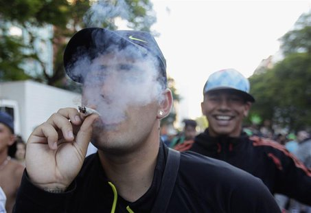 "People participate in the so-called ""Last demonstration with illegal marijuana"" on their way to the Congress building in Montevideo, as Sena"