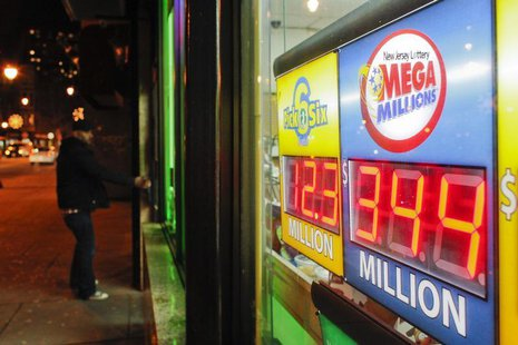 A customer arrives at a store where a Mega Millions sign is seen after the lottery grand prize rose to $344 million in New York December 7,