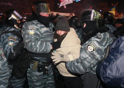 Riot police officers detain a protester in Kiev December 11, 2013. Ukrainian riot police moved in force early on Wednesday into part of the