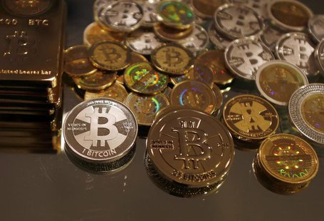 Bitcoins created by enthusiast Mike Caldwell are seen in a photo illustration at his office in Sandy, Utah, September 17, 2013. REUTERS/Jim