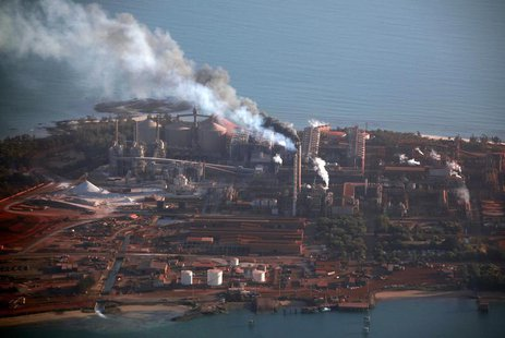 Smoke billows from chimneys at the Rio Tinto alumina refinery in Gove, also known as Nhulunbuy, located 650 kilometers (404 miles) east of D