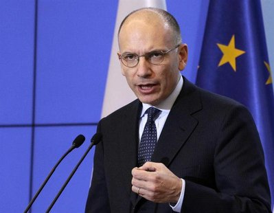 Italian Prime Minister Enrico Letta gestures as he speaks during a news conference at the Prime Minister's Chancellery in Warsaw, December 5