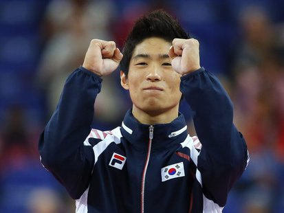 Yang Hak Seon of South Korea celebrates winning a gold medal in the men's gymnastics vault final in the North Greenwich Arena during the Lon