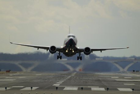 A passenger jet lifts off at Reagan National Airport in Washington February 28, 2013. REUTERS/Gary Cameron