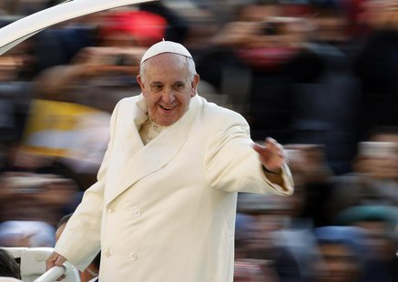 Pope Francis waves as he arrives to conduct his weekly general audience at St. Peter's Square at the Vatican December 11, 2013. REUTERS/Giam
