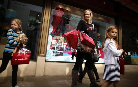 Joanne Bryant, 35, (2nd R) shops with Cariann Bryant, 8, (L) and Katie Sack, 8, at The Grove mall in Los Angeles November 26, 2013. REUTERS/