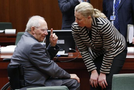 Germany's Finance Minister Wolfgang Schaeuble talks to his Finnish counterpart Jutta Urpilainen (R) during a European Union finance minister
