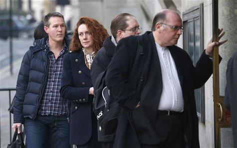 Former News International chief executive Rebekah Brooks queues as she arrives at the Old Bailey courthouse in central London December 10, 2