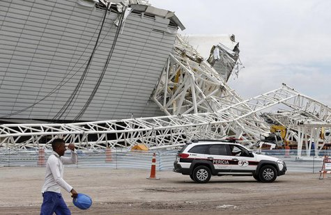 "A forensic police car arrives at the scene a collapsed crane at the Arena Sao Paulo stadium, known as ""Itaquerao"", in Sao Paulo December 2,"