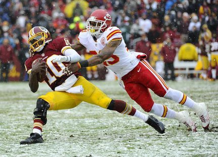 Dec 8, 2013; Landover, MD, USA; Washington Redskins quarterback Robert Griffin III (10) is tackled by Kansas City Chiefs safety Eric Berry (