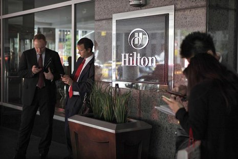 Guests wait outside at the Hilton, New York's largest Hotel, on Sixth Avenue June 13, 2012. REUTERS/Eduardo Munoz
