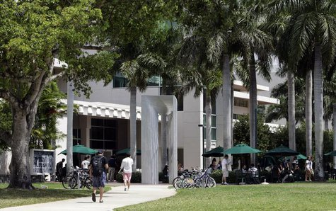 Students walk on the campus of the University of Miami in Coral Gables, Florida April 17, 2009. REUTERS/Joe Skipper